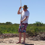 practicing holding the spear - kosi bay fish traps, spearfishing, tradition