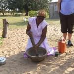 Tonga woman preparing traditional meal